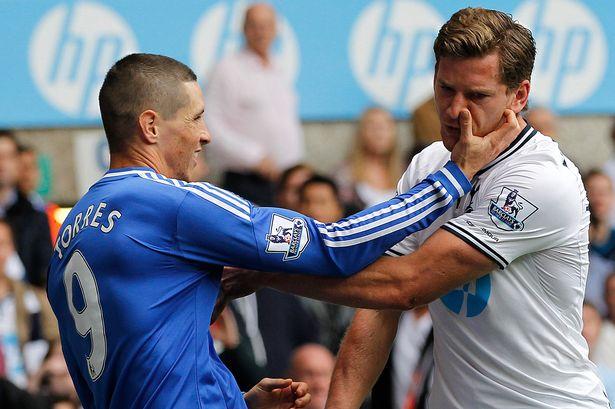 Chelseas-Fernando-Torres-L-tussles-with-Tottenham-Hotspurs-Belgian-defender-Jan-Vertonghen.jpg